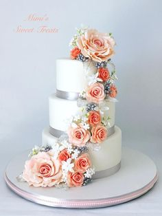 Cascading Flowers Wedding Cake by MimisSweetTreats