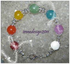 Beautiful Handmade Silver Chakra Bracelet with 7 Gemstones by IreneDesign2011 in my Etsy shop What do you think about this bracelet? I would really like to know, thank you :-D Maybe a gift idea for...