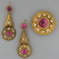 """A Victorian target brooch and matching earpendants The central cabochon amethyst bordered by polished beads Victorian Jewellery design was extremely symbolic, with the """"Target"""" Brooch expected to be struck by Cupids arrow, ensuring true love, passion and happiness for the lovers."""