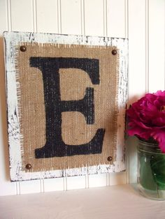 initial on burlap and distressed wood