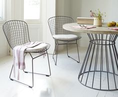 Laid-back, all-white kitchen style with industrial dining table and chairs. More decorating ideas at www.redonline.co.uk