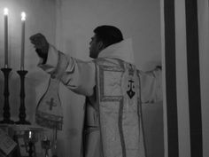 ordocarmelitarum: The priest stands with his arms outstretched in cruciform in the Carmelite Rite