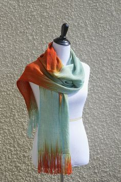 Hand woven long scarf, #pashmina scarf made in pooling technique. This means that color is gradually changes from blue to orange and red colors. Also there is a thin tencel ... #kgthreads #ombré