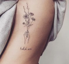 "outside right wrist: ""sisters are different flowers from the same garden"" with my sister (flowers more in hand)"