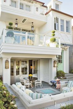 Three levels of exterior living, patio and balconies