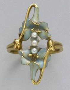 Ring by René Lalique, composed of gold, pearl and enamel, circa 1900.