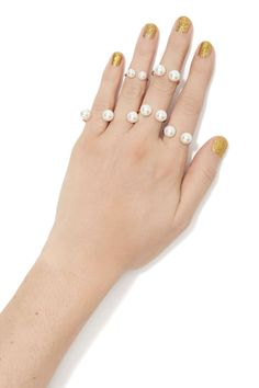 Golden nails and pearl rings