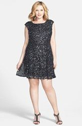 This short, sequined black dress is perfect for all of your holiday parties, from Christmas to New Years. Available in plus size!  Pisarro Nights Sequin Fit & Flare Dress (Plus Size)