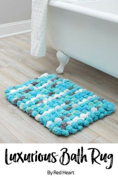 Luxurious Bath Rug free knit pattern in Pomp-a-Doodle yarn. Add an easy touch of coziness to your bathroom with this plush rug. Don't forget to attach a piece of nonskid mat to the bottom to prevent slipping! #bathmat #DIYpompom #pompomrug