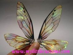 Fairy Wing Tutorials wings made out of something called Angelina Film that you can get at a hobby store. Beautiful!