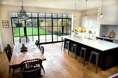 Keen to extend their house in Wandsworth, South West London, to create a large, light filled family kitchen and dining area opening directly onto the garden, Simon and Marissa Pilkington used a screen of steel windows and doors to provide a strong industr Family Kitchen, Living Room Kitchen, New Kitchen, Kitchen Decor, Kitchen Modern, Open Plan Kitchen Dining Living, Kitchen Layout, Kitchen Ideas, Kitchen Island Dining Table