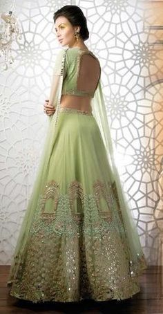 A must-have olive green Mughal themed lehenga with embroidered beautifully in olive and gold is perfect for wedding and reception parties.                                                                                                                                                                                 More