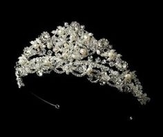 """Princess Swarovski and Freshwater Pearl Bridal Tiara by Fairytale Bridal Tiara. $111.99. The ornamented portion measures 9-1/2"""" wide and 2"""" tall,. Loop at both ends of the tiara allow you to fasten it in your hair with bobby pins. Freshwater pearls. Clear Swarovski crystals. A fairytale dream, this sparkling tiara is the perfect accessory for the classic bride. Freshwater pearls, rhinestones, clear Swarovski crystals, and seed beads weave into a stunning design. The ornamented po..."""