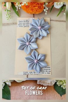 This is a listing for a beautiful set of 3 gray ribbon flowers made of: 2 simple flowers and 1 double layered flower. The flower appliques are perfect for any DIY project! Can be used for creating headbands, hair accessories, brooches, bouquets, corsages, mason jars, embellishing a scrapbook, making a greeting card or adding a special touch to a gift package. #flowers #ribbonflowers #craftflowers #flowersupplies #weddingflowers Grey Ribbon, Simple Flowers, Flower Applique, Gift Packaging, The Flash, Flower Crafts, Flower Making, Flower Decorations, Handmade Crafts