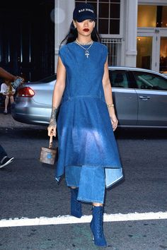 ☆Rihanna wears denim-on-denim in a Balenciaga dress, wide-leg jeans and Manolo Blahnik boots, with layered necklaces, a Louis Vuitton bag and graphic baseball cap.