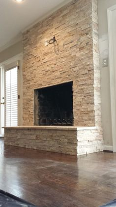 Image result for fireplace with stacked stone accents