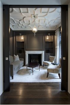interesting ceiling details. black walls are so dramatic