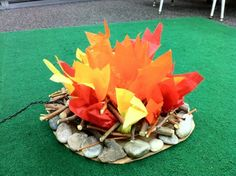 What camping theme would be complete withouta fake fire for the classroom? This one is made from rocks, twigs and tissue that I think could stand up to the classroom test.
