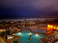 The beach is beautiful by day, but it really lights up at night. Have you ever seen the stars over the Gulf of Mexico? 💫   📷: Elizabeth Watson Simpkins Pensacola Beach Hotels, Night Light, Light Up, Gulf Of Mexico, In This Moment, Mansions, Photo And Video, Stars, House Styles