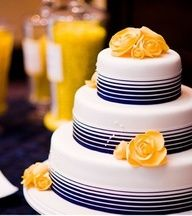 Navy & Yellow Wedding Cake. White cake with navy blue stripes and yellow flowers. No bakery name listed