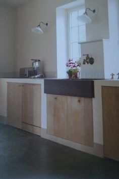 wooden cupboards and grey sink