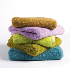 over time your bath towels will build up detergent and fabric softener residue, leaving them both unable to absorb as much water and smelling funny. run them through the wash once with hot water and a cup of vinegar, then again with hot water and a half-cup of baking soda. That strips the residue from them, and leaves them smelling fairly fresh again