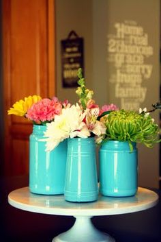 She's done it again! What a great post by @Traci Romine on painted jars and flower arrangements!