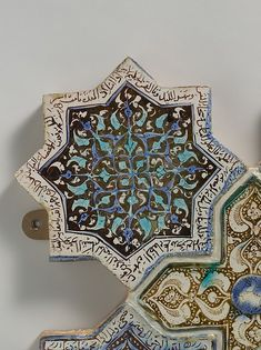 Eight-Pointed Star-Shaped Tile. Combining star- and cross-shaped luster tiles, this panel exemplifies the type of puzzle-like wall revetments popular in the Ilkhanid period. Some of the tiles shown here display inscriptions from the Qur'an or verses of Persian poetry. Their content reveals that the tiles came from differing architectural contexts - some religious, others secular - and only later were combined to create this display.