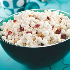 Ingredients •8 cups air-popped popcorn •2 ounces white baking chocolate, chopped •1 teaspoon butter •1/3 cup dried cranberries •1/4 cup ...