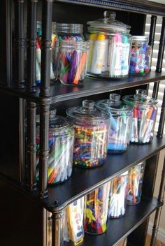Looking for ideas to store art supplies in handy, but inaccessible-to-my-toddler containers. Love the big glass jars.