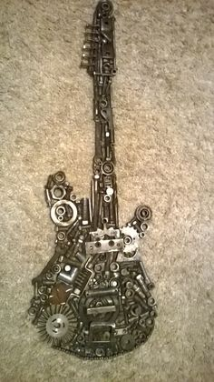 Hand made scrap metal guitar, full size.  Can be made to order, msg me for prices and info'.