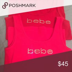 2 Bebe tanks (set) Worn once. Great condition! No missing stones. Size large bebe Tops Tank Tops
