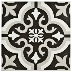 The lima ceramic tile in classic white and charcoal grey has the industrial appearance of cement and an intricate, symmetrical design. This encaustic piece features a fleur-de-lis white and ash grey design on a charcoal grey background. This durable tile is semi-vitreous, great for indoor applications.