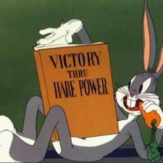 "Bugs reading ""Victory Through Hare Power"""