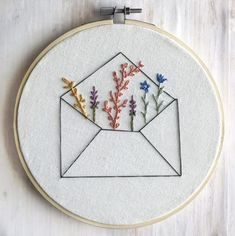 Envelope Wildflower Embroidery Hoop Wall Art, Long Distance Gift, Embroidery Hoop Art, Minimalist Decor, - - Embroidered wildflowers bursting from an unassuming envelope. A sweet reminder of how happy mail can be - especially for Embroidery Flowers Pattern, Embroidery Patterns Free, Hand Embroidery Stitches, Modern Embroidery, Embroidery Hoop Art, Simple Embroidery Designs, Hand Stitching, Beginner Embroidery, Machine Embroidery