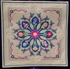 Dancing Dahlia by Laura Welkin won FIRST prize in Miniature Quilts at the 2015 AQS Quilt Show in Paducah. (The quilt also won first place at IQA Houston). All the winners: 1ST    DANCING DAHLIA, Laura Welklin,  2ND   COME ON TO MY HOUSE, Aki Sakai 3RD    1605 TEMPEST, Kumiko Frydl HM      1624 ARGENTUM, Susan Stewart HM      1608 CHRISTMAS ROSE, Carol Harris