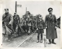 World War II in Pictures — Captured German forces. Notice the kid who was...