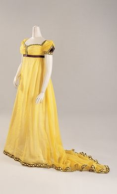Love the rich buttery saffron hue of this elegant evening down from the early 1800s. #regency #dress #gown #yellow #costume #clothing #antique #fashion