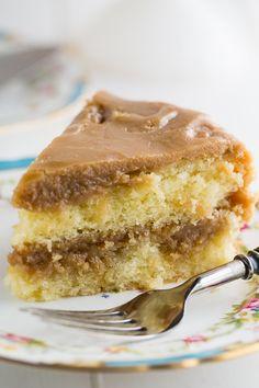 Southern Caramel Cake - moist vanilla cake slathered with lots of ultra-sweet caramel icing.