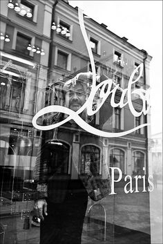 Christian Louboutin, sweet genius, stealthily peeking from behind a store window in Paris. Christian Louboutin Store, Paris Black And White, I Love Paris, Paris Girl, Paris Party, Visit France, Showcase Design, Fasion, World Of Fashion