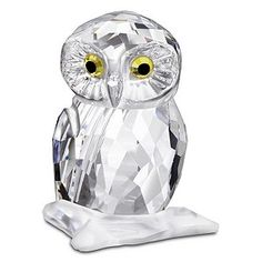 This adorable small owl is crafted in faceted clear crystal with light topaz crystal and jet crystal eyes that glimmer in the light as it sits on a faceted clear matt crystal branch. Beautiful craftsmanship and a wonderful gift for someone special.