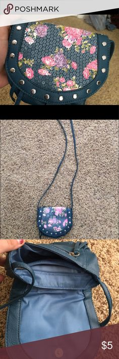 Small Purse Description: Cute little cross body bag! Great condition, only used a few times.  Size: OS  Measurements: From bottom of bag to top of strap - 31.5in, side to side - 7in, top to bottom of purse - 6in  Material: Unknown. Bag says man made. Bags Crossbody Bags