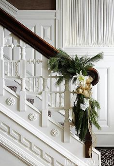instead of a garland all the way up the railing, a simple and a bow. Very classy and beautiful.