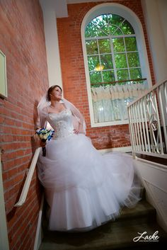 Dominion House has a variety of backdrops, beautiful windows, walls and doors that make for amazing wedding portraits.