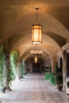 Piazza Toscana courtyard at Villa Siena with iron chandeliers to add to the Tuscan inspiration of this venue | Pinkerton Photography | villasiena.cc