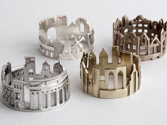 North Carolina-based goldsmith Ola Shekhtman designs these fun skyline rings that wrap entire cityscapes around your finger. So far she's managed to encapsulate the architectural highlights of over a dozen cities including Paris, San Francisco, Amsterdam, Stockholm, Berlin, Hong Kong and many more.