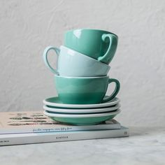 Zacry's coffee cups and saucers are available as pair - x2 coffee cups and x2 saucers in river blue or mint green colours. A 300ml fill to the brim. Available online - £22 - at: www.anotherplace.co.uk/gifts/coffee-cups.html