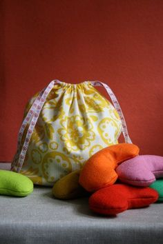 We made this simple drawstring bag to hold colorful felt jelly bean bags, but it can be used for a wide range of things. A custom gift wrap alternative, a travel bag, a knitting project bag and the list goes on and on. It sews up in less than an hour and works with any kind of fabric. A perfect use for those fabric scraps you've been wondering what to do with.