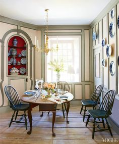 An odd angle but made beautiful and exciting instead.  In the dining room, an antique American drop-leaf table and a set of Windsor chairs pair with 17th-century Dutch Delft Peacock china.