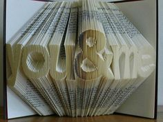 via Carol's thoughts:   FOLDED BOOK SCULPTURES....HOW AWESOME!    Now let me think about this........